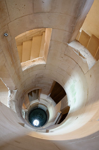 Château de Maulnes in Cruzy-le-Châtel, Burgundy, France: the well, axis of the central helical stairs which is also a skylight.