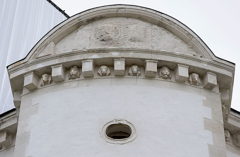 Château de Maulnes in Cruzy-le-Châtel, Burgundy, France:  modillioned cornice with dogs and lions heads of the north turret.