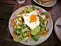 Chilaquiles, crema, fried egg, pickled jalapeño, radish, avocado.jpg