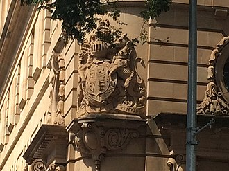 Family Services Building - Royal coat of arms sculpture over the entrance on the corner of George and Elizabeth Streets, 2015