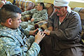 Coalition and Iraqi police forces team up to distribute micro-grant funds to assist local farmers DVIDS180622.jpg