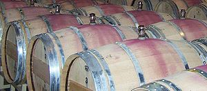 "Ullage (wine) - The ""red band"" seen on many wine barrels is from wine spill. Some of this spillage comes from the topping off process when the bung is reinserted into the barrel."