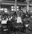 Conductor Toivo Haapanen leads the Finnish Radio Symphony Orchestra in concert at the Hietalahti shipyard in Helsinki, 24.5.1945..jpg