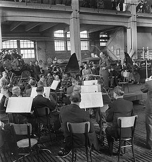 Finnish Radio Symphony Orchestra - Toivo Haapanen conducting the orchestra at the Hietalahti Shipyard in Helsinki, 1945