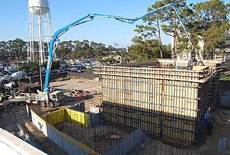 Concrete pump - Image: Construction site with concrete pump truck