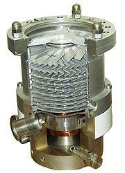 A cutaway view of a turbomolecular pump, a momentum transfer pump used to achieve high vacuum