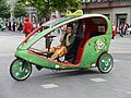 Cycle rickshaw driver on telephone in Dublin.JPG