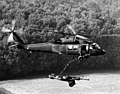 DA-SN-83-08456 U.S. Army UH-60A Black Hawk helicopter is used to airlift an M-102 Howitzer. Exercise Reforger 1982.jpeg