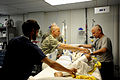Defense.gov News Photo 100512-F-0856M-601 - U.S. Army Capt. Andrew Kontowicz 2nd from right a nurse assigned to the 452nd Combat Support Hospital and Lt. Col. Davis Williams right an.jpg
