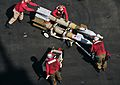 Defense.gov News Photo 110326-N-0074G-007 - Marines assigned to the aircraft carrier USS Enterprise CVN 65 push ordnance into place to arm an F A-18C Hornet assigned to Attack Squadron 251.jpg
