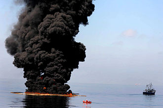 Controlled burn of oil on the ocean.