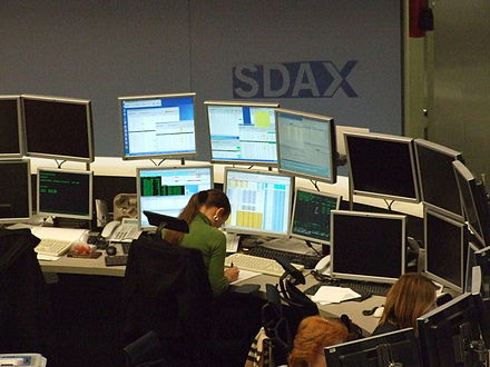 An electronic trading platform being used at the Deutsche Borse. Most 21st century capital market transactions are executed electronically; sometimes a human operator is involved, and sometimes unattended computer systems execute the transactions, as happens in algorithmic trading. Deutsche-boerse-parkett-ffm008.jpg