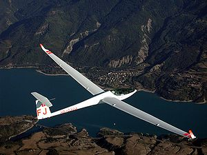 Glider (aircraft) - Single-seat high performance fiberglass Glaser-Dirks DG-808 glider over the Lac de Serre Ponçon in the French Alps