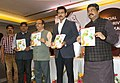 Dharmendra Pradhan and the Minister of State for Youth Affairs and Sports (IC) and Information & Broadcasting, Col. Rajyavardhan Singh Rathore releasing a special issue of Odia daily Nirbhaya, at its annual function.jpg