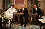 Dick Cheney and George H.W. Bush talk with newly crowned King Abdullah.jpg