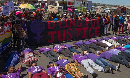 Soweto Pride 2012 participants protest against violence against lesbians. The country has strong human rights laws but some groups are still discriminated against. It is the first country in Africa to recognise same sex marriage Dying For Justice (8036294736).jpg