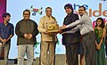 E.S.L. Narasimhan being presented a memento by the Chairman, CFSI, Shri Mukesh Khanna and the Joint Secretary (Broadcasting), Shri Puneeth Kansal at the concluding session of 19th edition ICFFI, at Shilpa Kala Vedika.jpg
