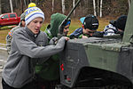 Eagle River High School hockey players work out with 1-Geronimo paratroopers 141025-A-ZX807-355.jpg