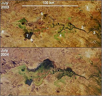 """Itezhi-Tezhi Dam - """"Not all floods are unwanted""""— NASA. The eastern (lower) half of the Kafue Flats in the middle of the dry season, one year apart. Water shows as dark areas, the Kafue's main channel shows as the squiggle running left to right. In early 2004 the floodgates of the Itezhi-Tezhi Dam (about 80 km off to the left of the photo) were opened to allow the natural flooding which used to happen before the dam was built. Compared to the previous year, much more of the flats remain inundated in the dry season and there is lot more vegetation (green colour). (Key: 1 Lusaka, 2 Kafue town, 3 Kafue Gorge Dam, 4, Mazabuka and Nakambala Sugar Estates, 5 Blue Lagoon National Park, 6 Lochinvar National Park, 7 Chunga Lagoon, 8 Kasenga.) Photo credit NASA/GSFC/LaRC/JPL, MISR Team."""