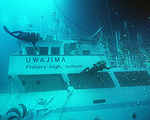 Divers inspect the wreckage of Ehime Maru off Oahu, November 5, 2001.