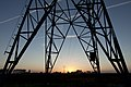 Electricity pylons at sunrise 2012.jpg