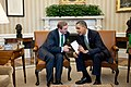 Enda Kenny and Barack Obama confer in the Oval office.jpg