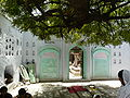Entrance to grave enclosure within Qutbuddin Bakhtiyar Kaki's dargah compound.jpg