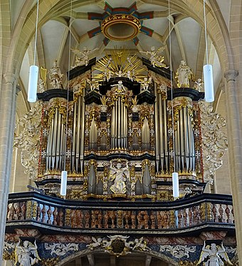 The organ of the Severikirche in Erfurt, Thuringia, Germany, has a highly decorative case with ornate carvings and cherubs. Erfurt St. Severi 01.jpg