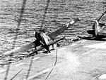 F6F Hellcat crashing over the side of USS Saipan (CVL-48), circa in 1946.jpg