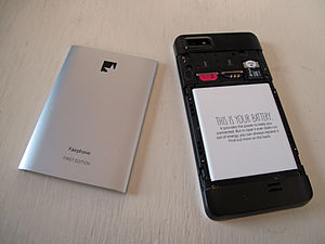 Fairphone 1 - Fairphone 1, with the back lid removed. Removable battery, dual SIM slots and one SDHC card slot are visible.