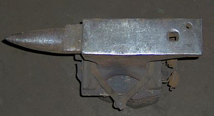 A top view of a well-used London pattern anvil Fciron-anvil face.jpg