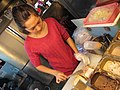 Female street vendor making Coffin Bread at Shilin Night Market.jpg