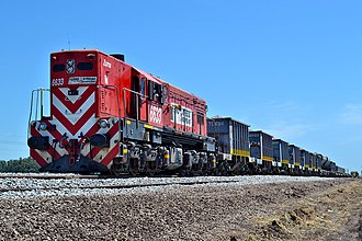 Ferroexpreso Pampeano - A Ferroexpreso locomotive carrying rail construction materials.