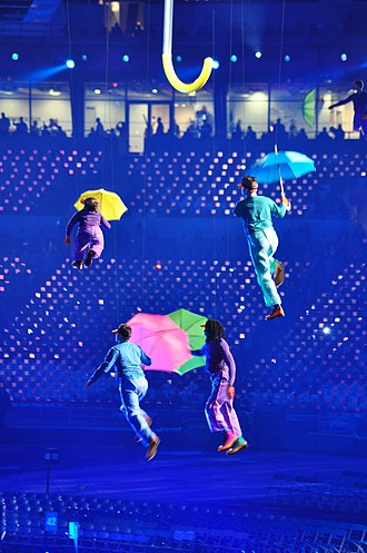 2012 Summer Paralympics opening ceremony - Performers holding umbrellas fly around the stadium.