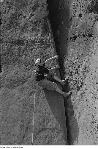 "Rock climbing - Climbing in Germany, circa 1965. Note the lack of intermediate protection points and the potentially unsafe tie-in method, which demonstrate the maxim of the day: ""The leader must not fall""."