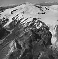 Fourpeaked Mountain, mountain glaciers with firn line, and bergschrund along upper portions of the mountain, August 24, 1960 (GLACIERS 6512).jpg