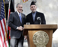 March 1, 2006, President George W. Bush and Hamid Karzai appear together in Kabul, Afghanistan.
