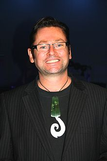 A man in his 40s wearing a Pounamu pendant
