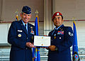 Gen Norton Schwartz presents AFC to SSgt Robert Gutierrez.JPG
