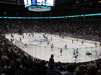 Ice hockey arena - Canada Hockey Place was the main venue at the 2010 Winter Olympics in Vancouver. Here, we see the Vancouver Canucks (blue) and the New York Rangers (white) warming up before a game.
