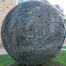 A three metre-diameter globe-shaped bronze sculpture fabricated out of brazed copper alloy wire