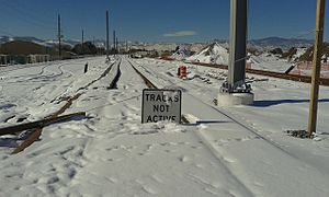 G Line (RTD) - Gold Line covered in snow near the Ward Road station.