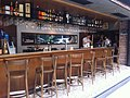 HK Central 擺花街 Lyndhurst Terrace sidewalk restuarant bar table n chairs n tender Oct-2011.jpg