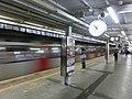 HK MTR Tai Wai Station night platform clock sign Nov-2013.JPG
