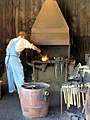 Heating metal in the forge fire (7869081214).jpg