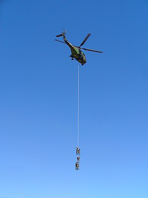 Helicopter Rope Suspension Technique - Soldiers suspended beneath a Puma helicopter
