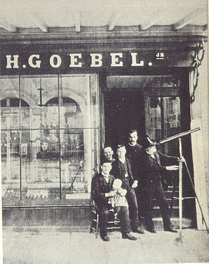 Heinrich Göbel - Goebel-Shop in New York, Grand Street. Probably this photo was taken in the year 1893 to support the Goebel-Story. The telescop which Göbel used in the 1850s on a horse wagon was much larger.