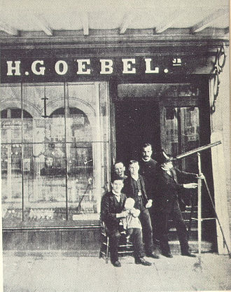 Heinrich Göbel - Goebel-Shop in New York, Grand Street 468. Probably this photo was taken in the year 1893 to support the Goebel-Story. The telescop which Göbel used in the 1850s on a horse wagon was much larger.