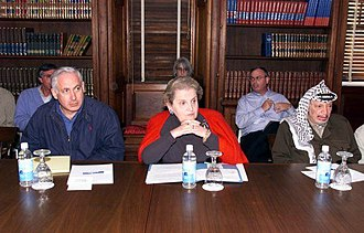Benjamin Netanyahu - Netanyahu sitting with U.S. Secretary of State Madeleine Albright and Palestinian President Yasser Arafat at the Wye River Memorandum, 1998