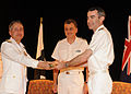 Hrs 101014-N-5429S-037 Pakistan navy Rear Adm. Zafar Mahmood Abbasi, outgoing Combined Task Force 150 commander, left, passes a ceremonial scroll.jpg